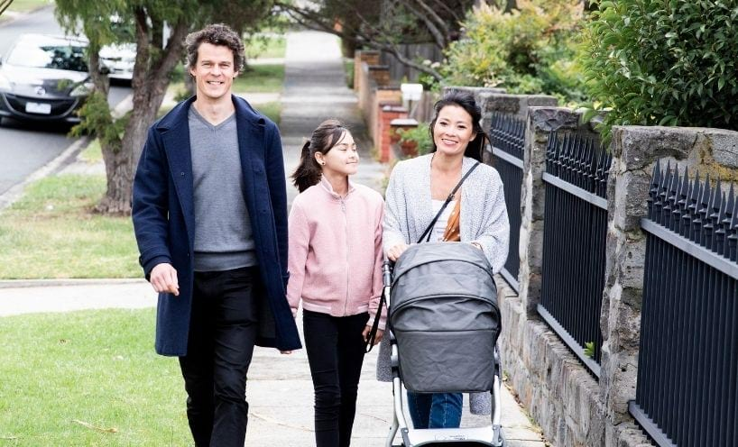 Family-walking-along-sidewalk