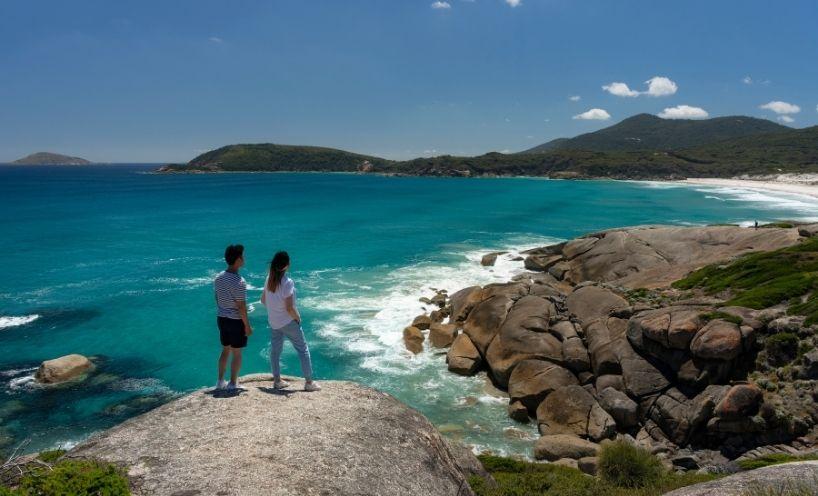 Two people looking at ocean view