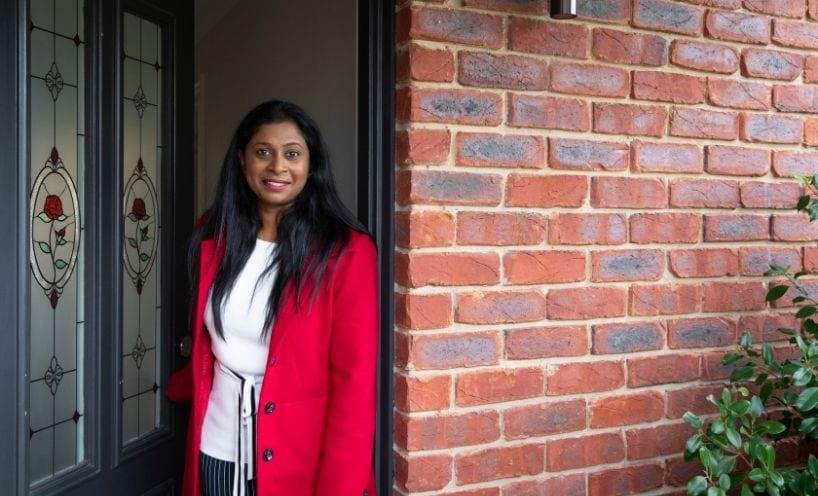 Woman-standing-at-doorstep