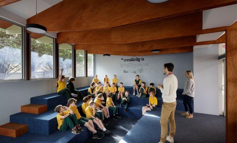 Teacher speaking with school children