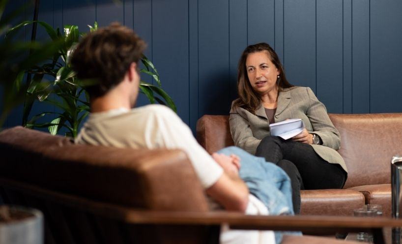 Woman talking to man in a formal setting