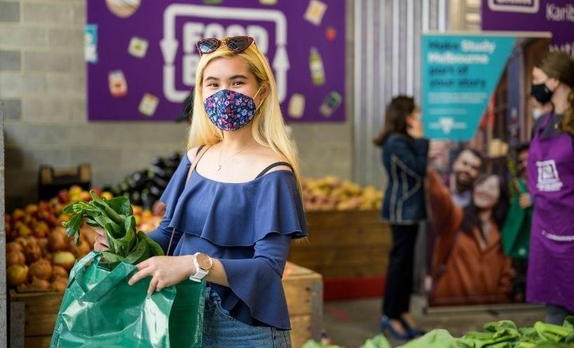 Young woman shopping Foodbank facemask